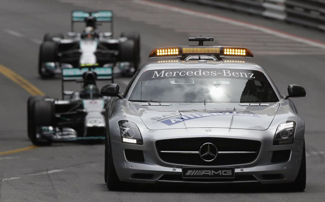 Mercedes Formula One driver Rosberg of Germany and teammate Hamilton of Britain follow a safety car during Monaco F1 Grand Prix