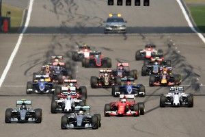 The pack head out on the first lap at the start of the Formula One Chinese Grand Prix in Shanghai on April 12, 2015.    AFP PHOTO / JOHANNES EISELE        (Photo credit should read JOHANNES EISELE/AFP/Getty Images)